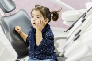 Little Girl with Pigtails Feels a Little Anxious at the Dentist